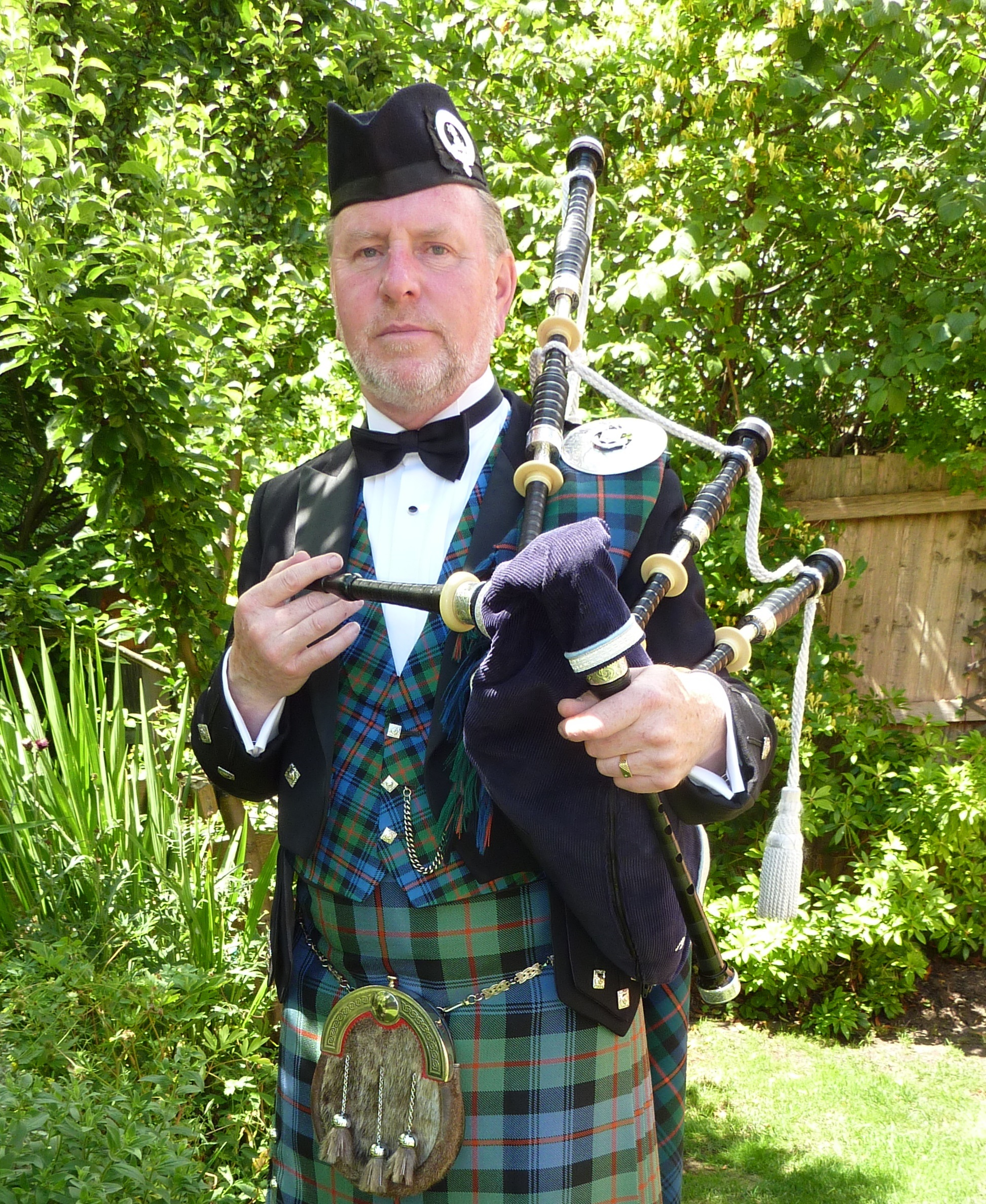 Bagpiper Pipe Major Alan J. Harrison